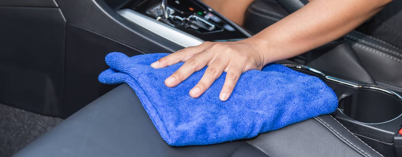 cleaning leather seat with microfiber towel